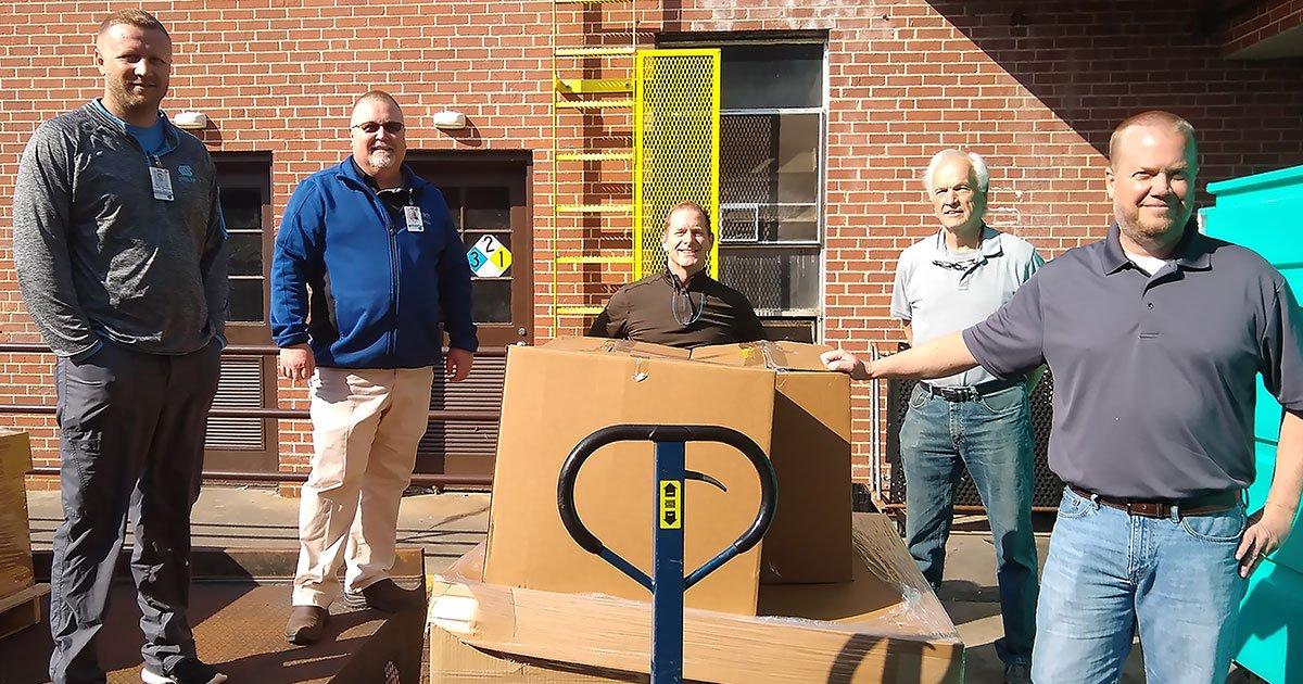 Men from Westbridge surrounding donation