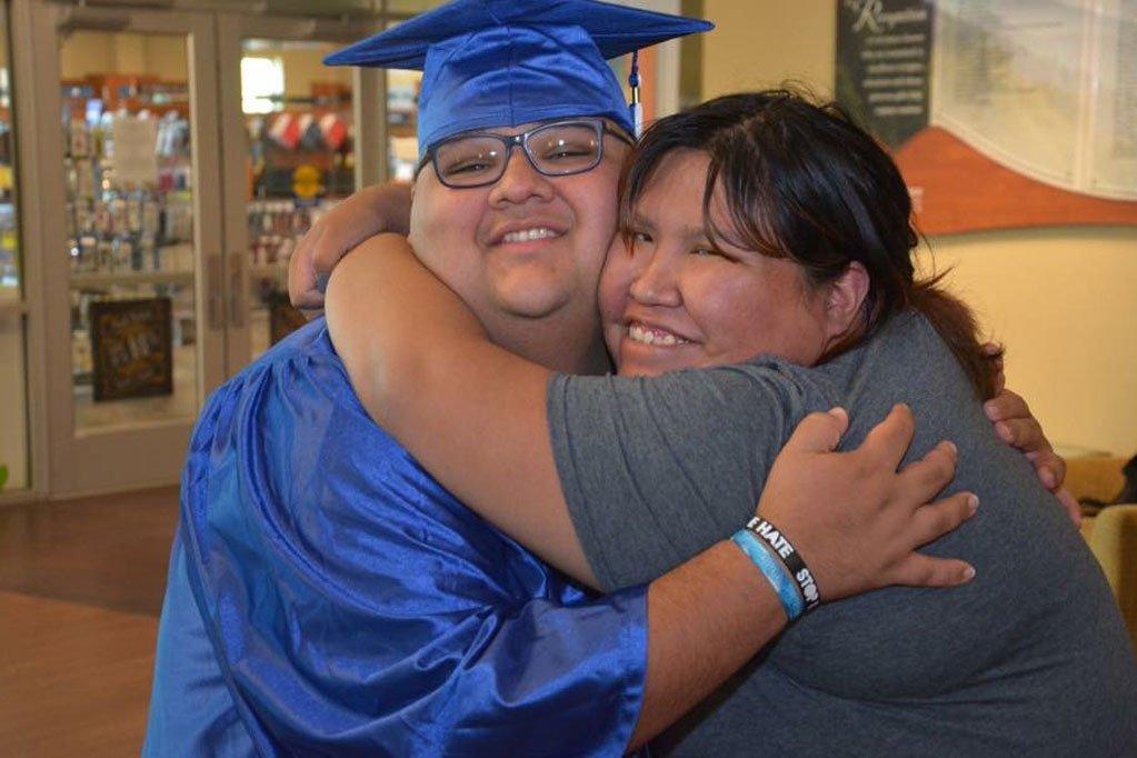 Cherokee graduate getting hug